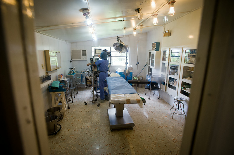 Haiti. An anesthesiologist for Surgical Volunteers International prepares the monitoring system that will be used to evaluate the patient's vital signs during surgery.
