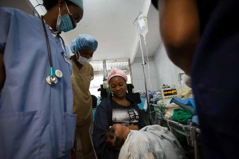 A mother is reunited with her child following a surgery to correct a cleft lip.