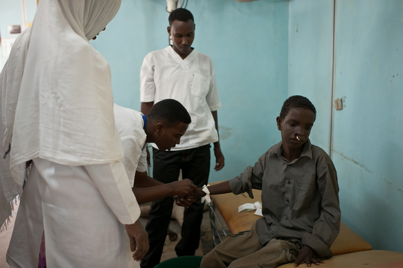 A nurse takes a sample of blood prior to a surgery to correct a cleft lip deformity. Mogadishu, Somalia.