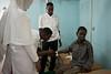 A nurse takes a sample of blood prior to a surgery to correct a cleft lip deformity. Mogadishu, Somalia.