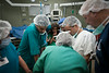 Palestinian medical residents observe as volunteers from an American based surgical team prep a patient at the Al-Ahli hospital in Hebron, Palestine.