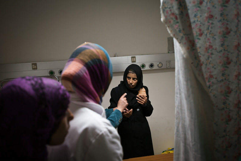 Hebron, Palestine. A Palestinian woman gets ready for surgery to repair her cleft lip at the Al-Ahli hospital.