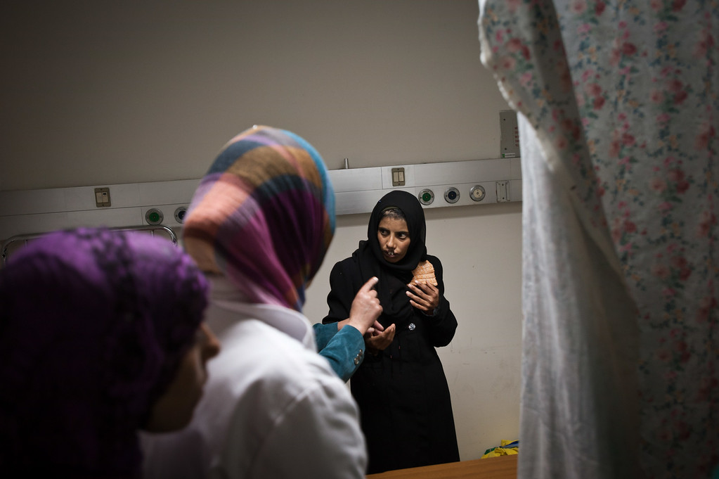 A Palestinian woman gets ready for surgery to repair her cleft lip at the Al-Ahli hospital in Hebron, Palestine.