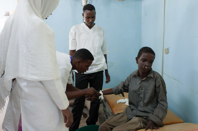 I came across this young boy in an IDP (Internally Displaced Persons) camp in Mogadishu, Somalia while documenting another project. Due to my affiliation with Smile Train, I was able to help facilitate his corrective surgery (along with two other young children) with the help of the head surgeon at Medina Hospital in Mogadishu. This image was taken an hour before his surgery.