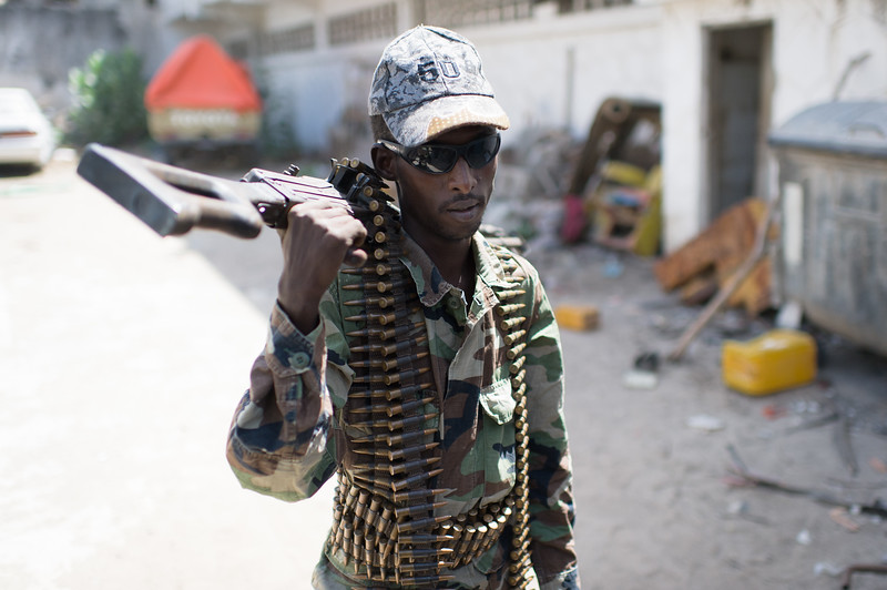A solider armed with a mid caliber machine gun prepares to go on security patrol at the TFG base station in the Hodan District of Mogadishu, Somalia.