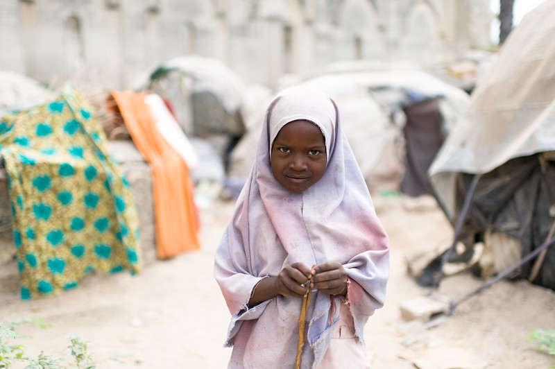 A young internally displaced person on the grounds of the Cathedral of Mogadishu. The Cathedral of Mogadishu is located in the Hamar Weyne district, which is the oldest town in Mogadishu. The cathedral was built in 1928 by Italian colonists and destroyed by Islamic fundamentalists in 2008.