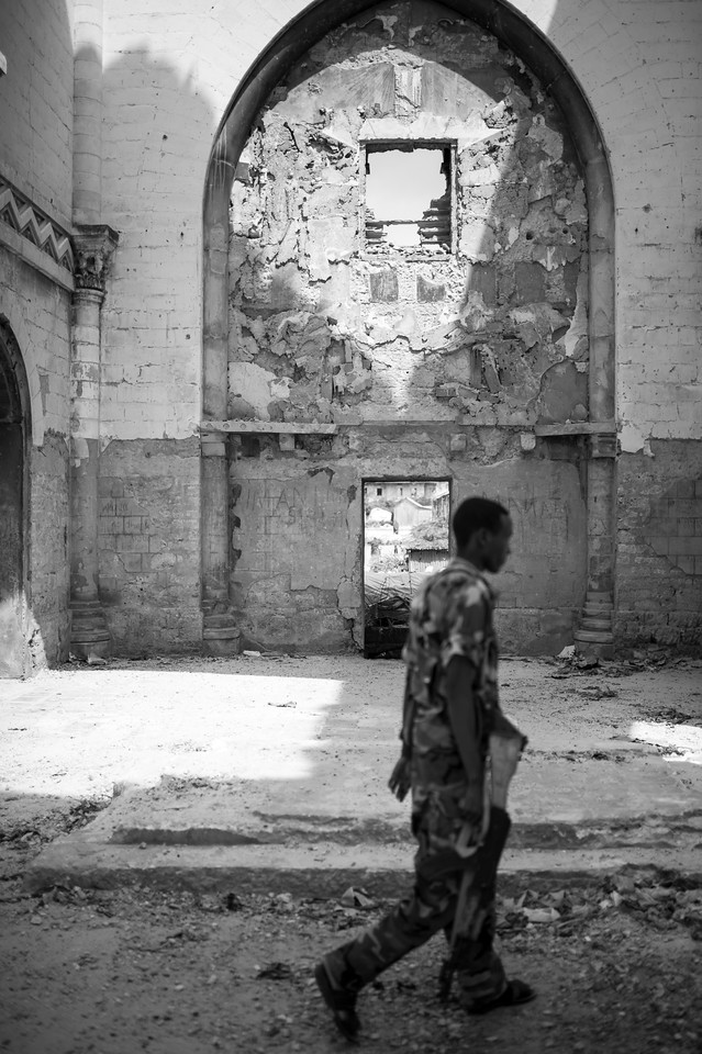 TFG soldiers patrol the Cathedral of Mogadishu. The Cathedral of Mogadishu is located in the Hamar Weyne district, which is the oldest town in Mogadishu. The cathedral was built in 1928 by Italian colonists and destroyed by Islamic fundamentalists in 2008.
