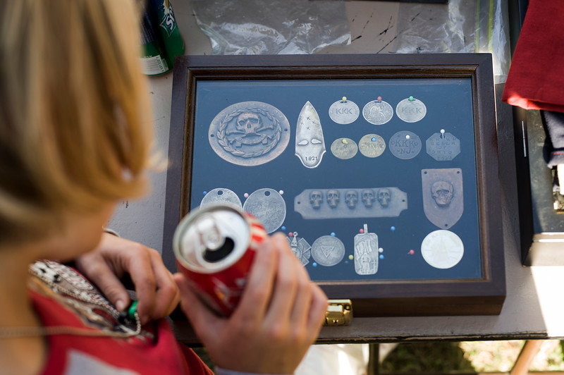 A display case of vintage Klan medallions offered for sale at a unity gathering hosted by a southern based KKK realm.