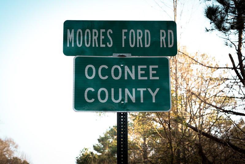 "Monroe, GA. 12/10/2015. The Moore's Ford Bridge incident, widely described as the US's last mass lynching, stands out as a particularly brutal case even in Georgia, where more lynching's were recorded between 1877 and 1950 than in any other state, according to an EIJ (Equal Justice Initiative) report.<br /> <br /> The victims of the lynching, who were African-American sharecroppers, were killed after Roger Malcom was bailed from Walton County Jail on charges of stabbing Barnette Hester, a 29-year-old white farmer. Hester was rumored locally to be having an affair with Roger's wife, Dorothy.<br /> <br /> The couples were seized by a crowd at Moore's Ford Bridge while being driven home in a truck by Loy Harrison, a white farmer who had paid to bail Malcom out of jail on July 25, 1946. The women were tied to an oak tree beside their husbands and the mob fired three times at point blank range hitting their victims 60 times. The crowd then cut open the stomach of Dorothy Malcom, who was 7-months pregnant and removed the fetus.<br /> <br /> Harrison, who escaped unharmed and said he was ambushed, has been accused by civil rights activists of being a Klan member and helping to set up the lynching. According to one witness, ""a Confederate flag was flown at the crime scene next to a Walton County Sheriff's car. This was to show people that this was a Ku Klux Klan killing and law enforcement was involved."" For years, no one in Walton County would talk with authorities about the case. When a 1946 grand jury failed to identify any suspects, the FBI pulled out of the active investigation.<br /> <br /> In 2013, during an interview with the NAACP, Wayne Watson named seven men who he claimed to have heard speaking about their involvement in the murders. Watson alleged that all seven men, including his uncle were members of the Ku Klux Klan.  The 69-year old case was reopened and is pending investigation by the FBI."