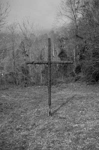 A 12-foot wooden cross wrapped in burlap and doused with a mixture of kerosene and oil (Klan Cologne).