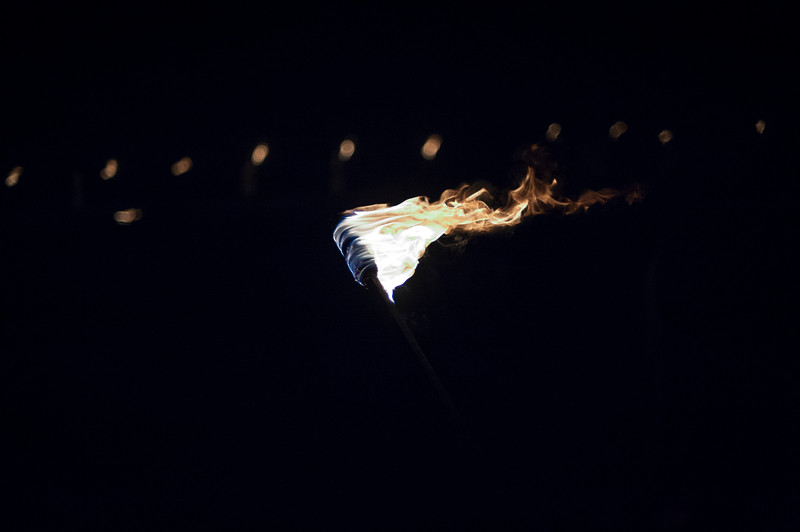 Ku Klux Klan members from several Klan realms partake in a cross lighting ceremony.