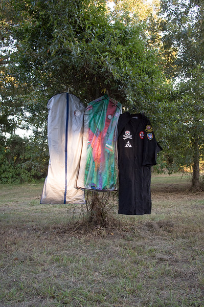 Louisiana. 2007. Klan robes hang from a tree at Klan rally hosted by the Bayou Knights of the Ku Klux Klan.