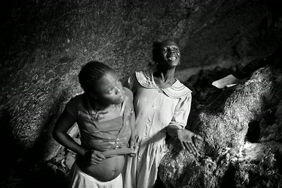 A Mambo (high priestess in Haitian Vodou) is overcome by a spirit in a cave once inhabited by the Taino Indians. Central Plateau, Haiti.