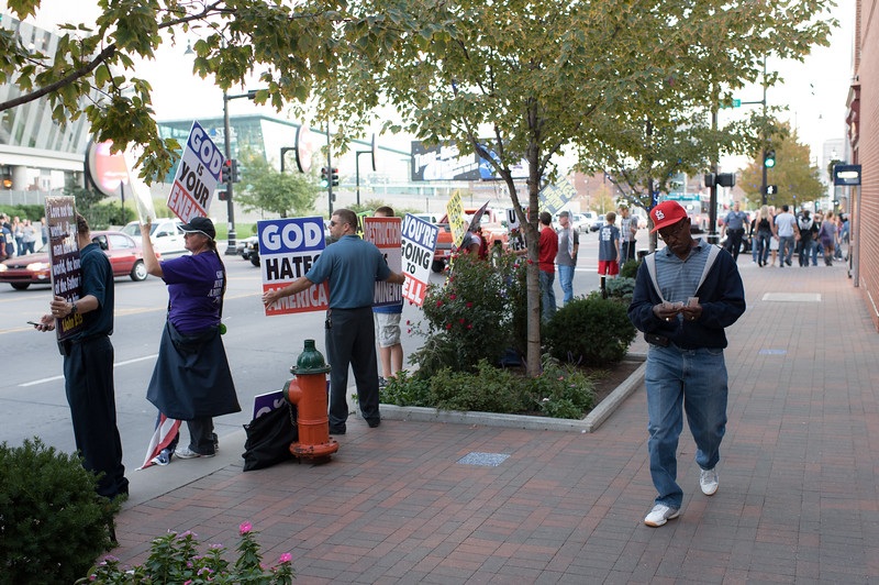 Westboro Baptist Church members protest society and it's demoralization during a concert in Kansas City, MO by Enrique Igesias.