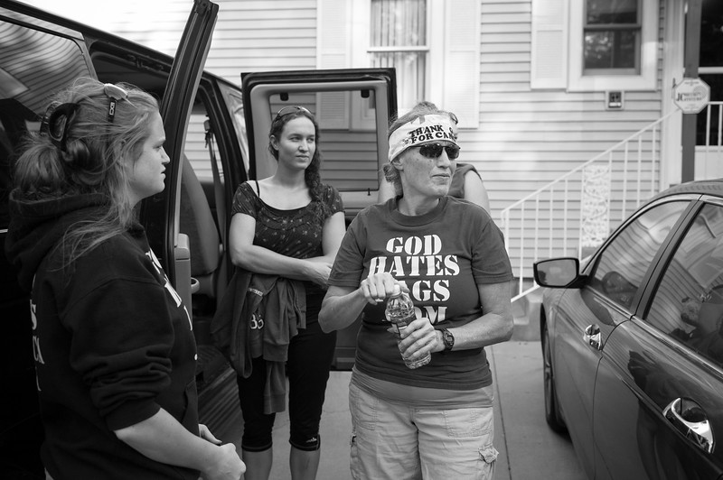 Rebekah, Megan and their mother Shirley Phelps-Roper making final convoy plans before heading out to picket a musical concert by Enrique Igesias an hour away in Kansas City, MO.
