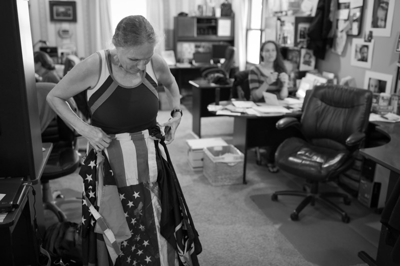 54-year old law office manager Shirley Phelps-Roper, in her home office in Topeka, KS., adjusts a makeshift skirt she routinely wears during pickets.