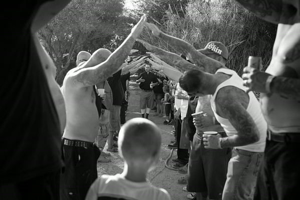 Wedding ceremony held at the annual Oi Fest, sponsored by the White Knights of America, Death Head Hooligans and the Sons of Aesir motorcycle club. Arizona.