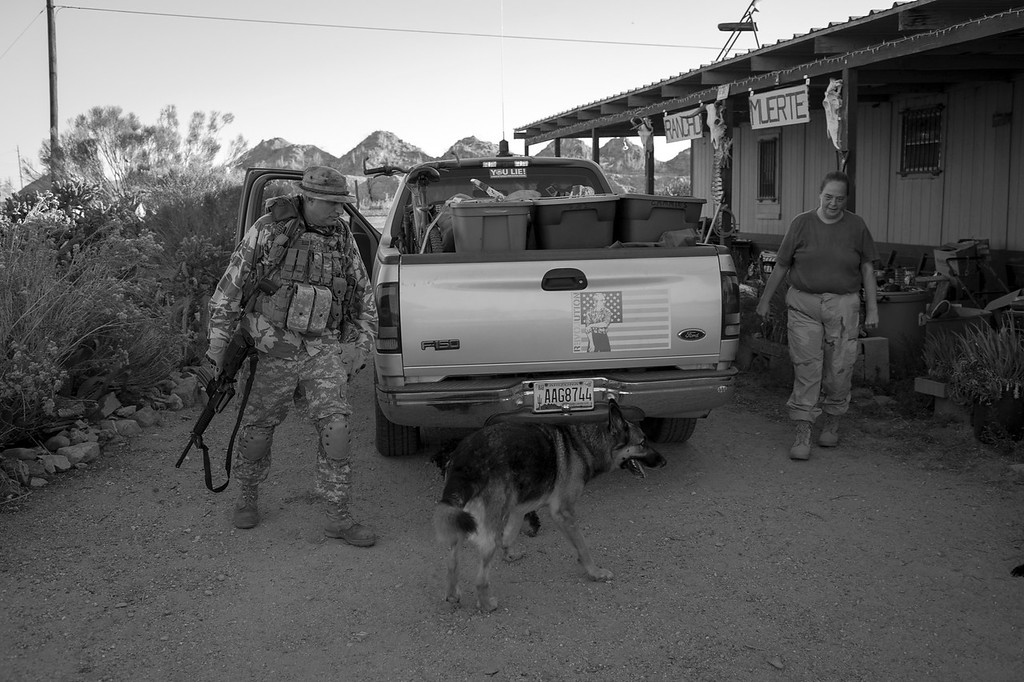 Harry Hughes (left) of the National Socialist Movement Arizona Division prepares for a two-day border patrol, which will take place in Arizona's Vekol Valley. The Vekol Valley region is synonymous as a super highway for illegal immigrants and drug trafficking between Mexico and the United States.