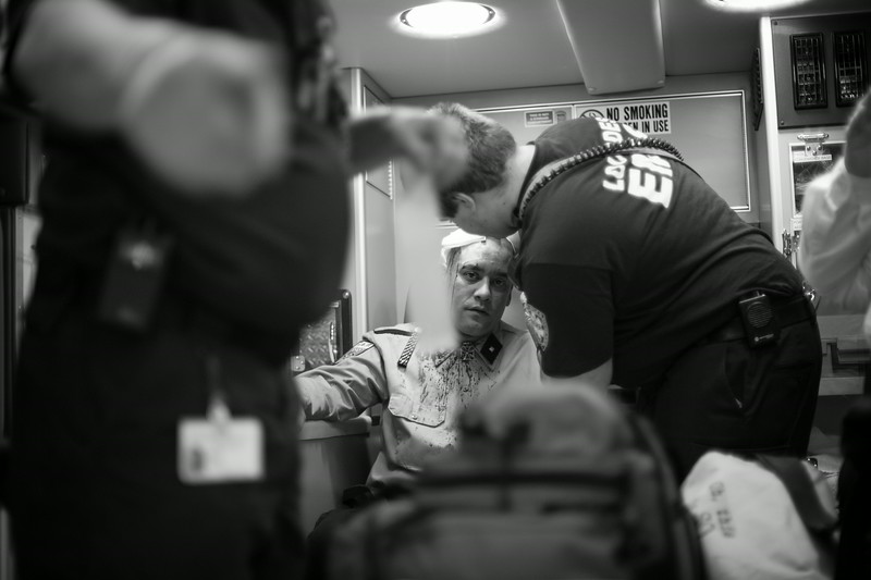 A member of NSM (National Socialist Movement) recieves medical attention after their annual congress is attacked by a group of protesters. New Jersey.