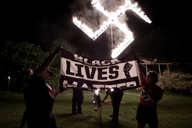 7/18/2020. Two white nationalists take part in burning a Black Lives Matter flag. Moments prior, three attendees took turns urinating on the flag, followed by them dousing it with kerosene.
