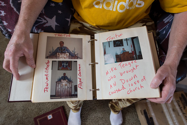A former high ranking officer of Richard Butler's Aryan Nations with his photo scrapbook.