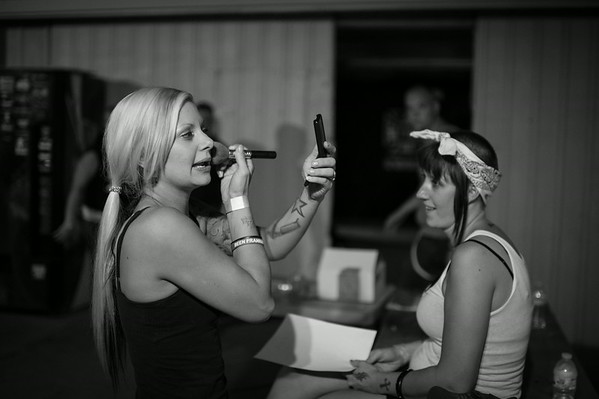 A skinbyrd (female skinhead) applies makeup a during a band break at the Golden State Awake concert sponsored by GSS. California.