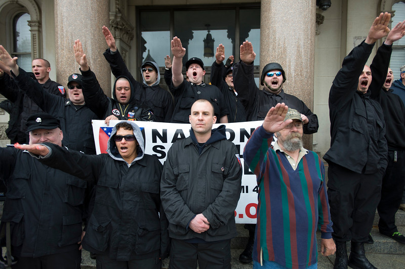 Commander Jeff Schoep (front row center)of the NSM (National Socialist Movement).