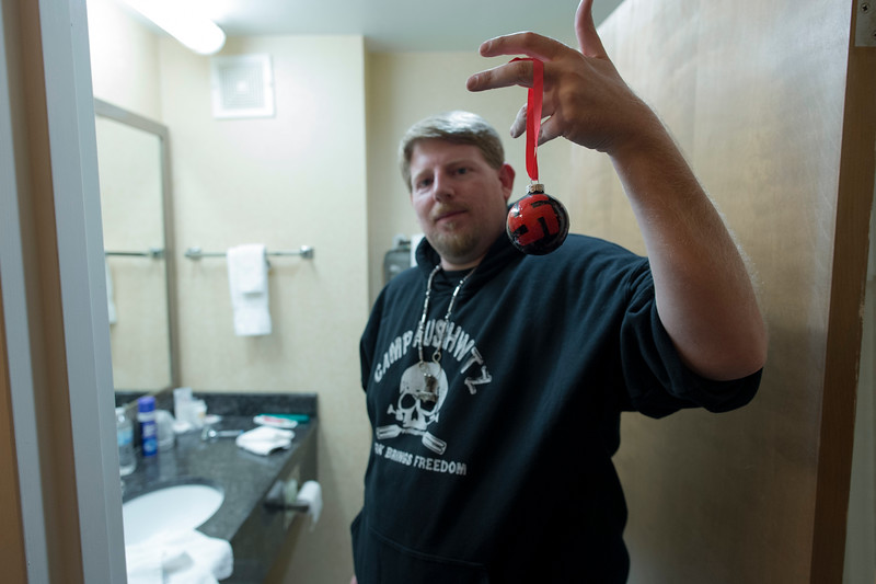 11/5/16, Mechanicsburg, PA. A white nationalist shows off a Swastika Yule ornament in his hotel room following a rally at the Pennsylvania State Capital building.