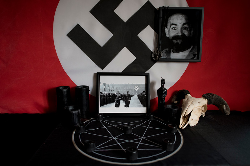 The altar of a white nationalist who follows the satanic Left-Hand Path of The Order of Nine Angles (o9a/ONA). Some refer to this amalgamation of ideologies as Esoteric Hitlerism/Nazism.