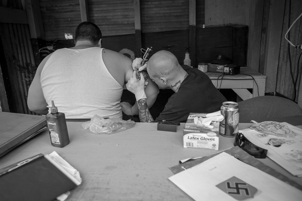A tattooist at the Imperial Klans of America (IKA) annual Nordic Fest. Nordic Fest is a 3-day event which takes place on the IKA's 15-acre paramilitary compound. Dawson Springs, Kentucky.