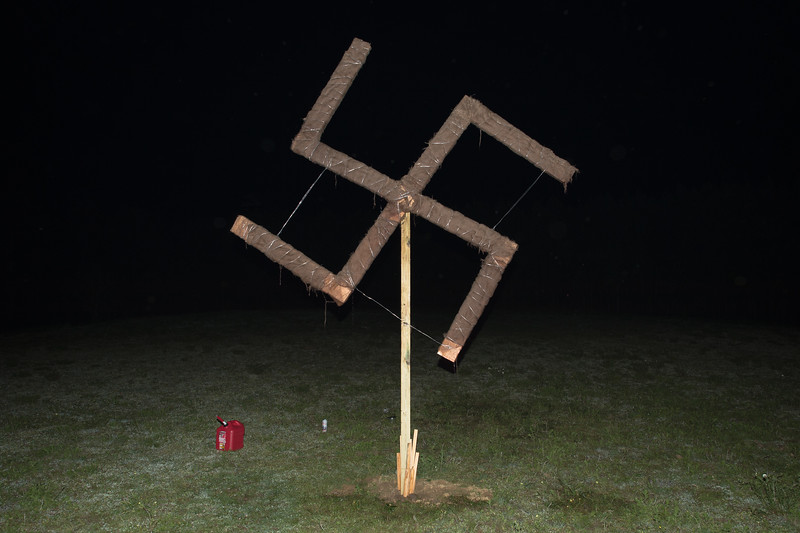 April 23, 2016. Temple, Georgia. A 12-ft wooden Swastika, wrapped in burlap and doused with a mixture of Kerosene and motor oil was set aflame, along with a wooden cross at the culmination of the weekend's events.