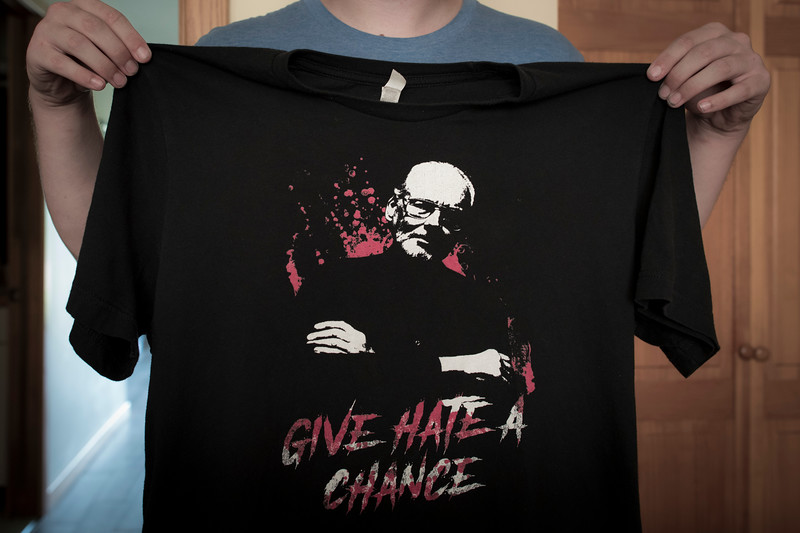 "A tee-shirt bearing the image of James Nolan Mason owned by a former member of Atomwaffen.<br /> <br /> As an unaffiliated white nationalist for over a decade, most of which took place during his teenage years, this former member of the Atomwaffen Division initially joined via an online forum in 2016. Not long after, he was invited to an AWD chapter where he began attending regular meetups on the East Coast.<br /> <br /> As it was told to me, he became ""tired of being around sociopaths playing commando."" When asked to elaborate he clarified he was referring to ""people who believe that their group formed on Wire will school-shoot their way to victory and be able to destroy the system. And, they are usually mentally ill and attracted teens with death wishes."" I saw them as lead by unprofessionals and the group as having no future in a movement that at the time was getting more professional.<br /> <br /> The Atomwaffen Division was a small American Nazi group established by former Iron March social network users. Mason, a former leader of the National Socialist Liberation Front and Universal Order was seen as a mentor to the AWD. Atomwaffen members openly promised further violence and an upcoming race war. The organization was disbanded by Mason in 2020 shortly after the U.S. State Department moved to have Atomwaffen designated as a foreign terrorist group."