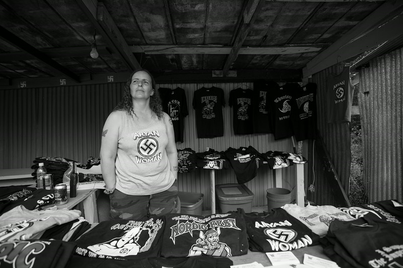 A female member of the Imperial Klans of America at work selling various clothing items during the annual Nordic Fest. Dawson Springs, Kentucky.