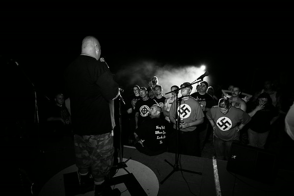 Charles (36), a Lieutenant in the NSM, addresses the crowd shortly before a Swastika lighting ceremony at the Hated and Proud concert, which was held on a small farm in America's heartland. Iowa.