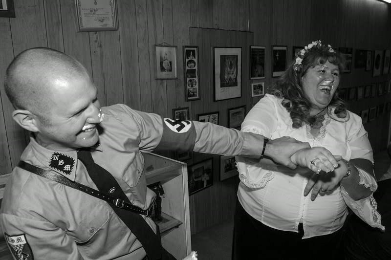 Christine and Steven celebrate just getting married by smearing wedding cake on one another in Laurens, S.C. on April 21, 2007. The wedding was performed in Nazi tradition with text borrowed in part from an original 3rd Reich Era SS style wedding ceremony.