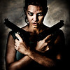 """September 24, 2006  Sunny is battle hardened.  I went wild on a production photo I shot for <a href=""""http://www.jabroniepictures.com/"""">Jabronie Pictures' movie Gunpoint 2</a>  More of the production photos I've been working on are in <a href=""""http://joshfreeman.smugmug.com/gallery/1912365"""">this gallery</a>"""
