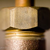 December 12, 2006<br /> <br /> I'm really into the macro this month, this is a nut on an outdoor faucet.