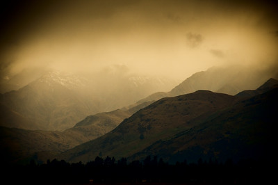 Winter storm Wanaka.  The mountains with storm clouds darken The light a threatening blackness envelops You feel the wind upon your face as it rushes to catch the storm A whisper of hail, maybe snow sighs upon the wind  Of a winter storm....  (text via Rachel Jennings)