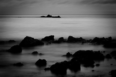 And as the evening turned grey his eyes turned to the rocks which closed his mind with a deepening darkness.