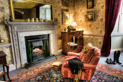 National Geographic in Front of the Fire Dunster Castle Dunster England