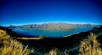 Lake Wakatipu 180  This panorama of Lake Wakatipu encompasses an area that is probably the most filmed in New Zealand.  On the left is Glenorchy and the Dart River which has featured in The Lord of the Rings, X-Men - Wolverine, The Lion, The Witch & The Wardrobe, Prince Caspian and The Lovely Bones amongst others. The number of advertisements is just too big to list.  To the right is Mt Nicholas, filmed in The Waterhorse.  In fact, you could make a location guide right here - note to self........  Thanks to Alfie Speight and Glacier Southern Lakes Helicopters for the opportunity.