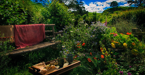 A quiet seat for relaxation The Joy of Summer and Flowers Hobbiton Movie Set Matamata New Zealand