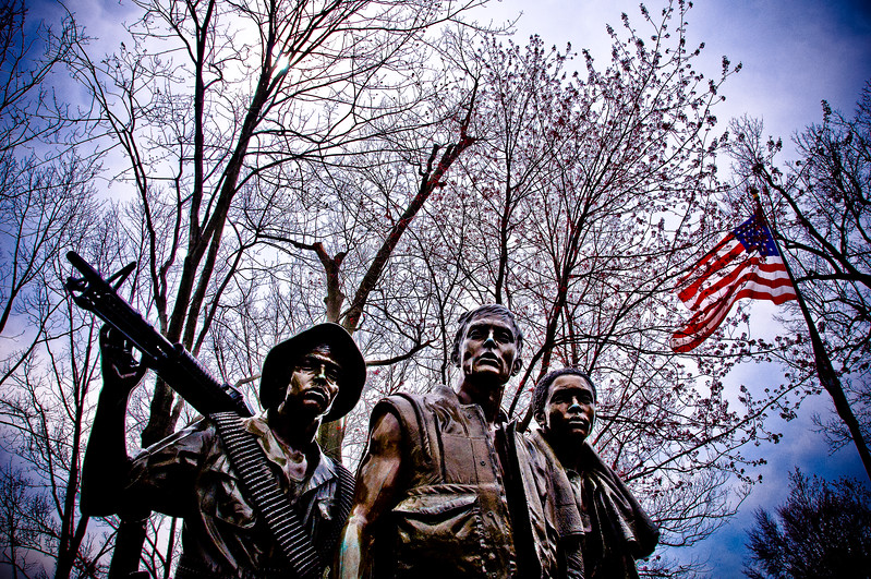 We Will Remember Them (II)<br /> The Three Soldiers Memorial, Washington DC<br /> <br /> My attempt in capturing this striking statue was to show these three American soldiers from the Vietnam War, alone against a stark background with nothing but the American flag in colour to show the support of the families at home. The blue edges are the storm from the north enveloping them in danger.