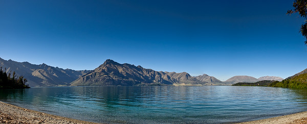 Closeburn It is an absolute joy to walk the shores of Lake Wakatipu at Closeburn. The heady aroma of St Johns Wort, thyme and briar roses mixing with aromatic pine brings Ithilien to life. An idyllic location.  A 12 image panorama.