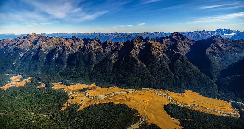 As we flew across the tops we looked down on the road.<br /> It enticed us to repeat the journey.<br /> Milford Road
