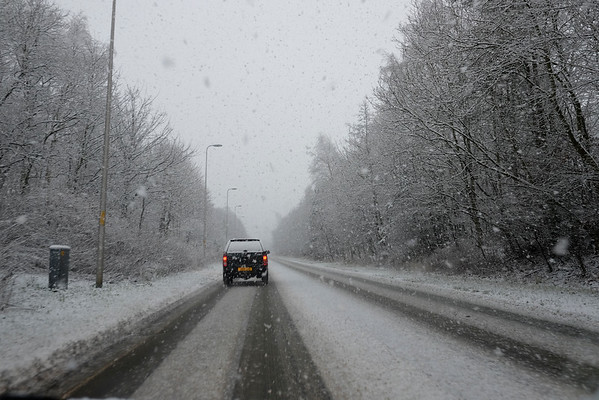 Sudden snowfall hampers travel
