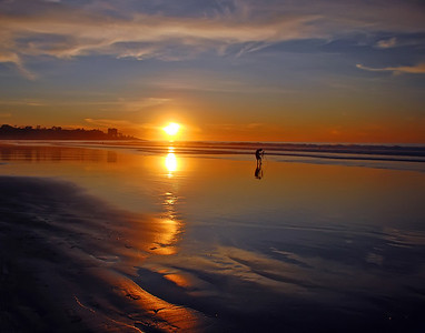 """Photographer at Sunset"" Sunset at La Jolla Shores, California, taken on the first day of the new year."