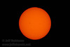 The very beginning of the Transit of Venus (look at about 12:30 on the edge of the sun). Shot with Olympus 1000mm lens @f16 with a Seymour Solar 475 glass filter (6/5/2012 - Folsom, CA)