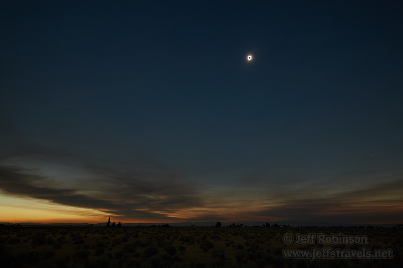 Wide/landscape shot of the eclipse during totality. Note the bright sky towards the eastern horizon, as the totality hasn't yet reached over there. (8/21/2017, 6152 Northwest Danube Dr., Madras eclipse trip)<br /> EF16-35mm f/4L IS USM @ 16mm f5.6 1/2.5s ISO400