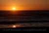 The setting sun over the ocean waves. (9/11/12, Beach 3, Olympic National Park)
